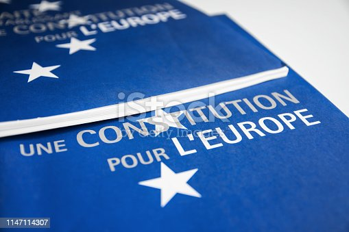 1126684642 istock photo Close-up on French European Union constitution documents blue colored in selective focus 1147114307