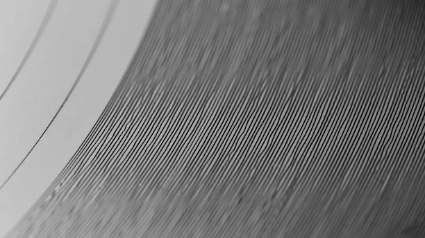 Closeup on grooves of record on turntable stock photo