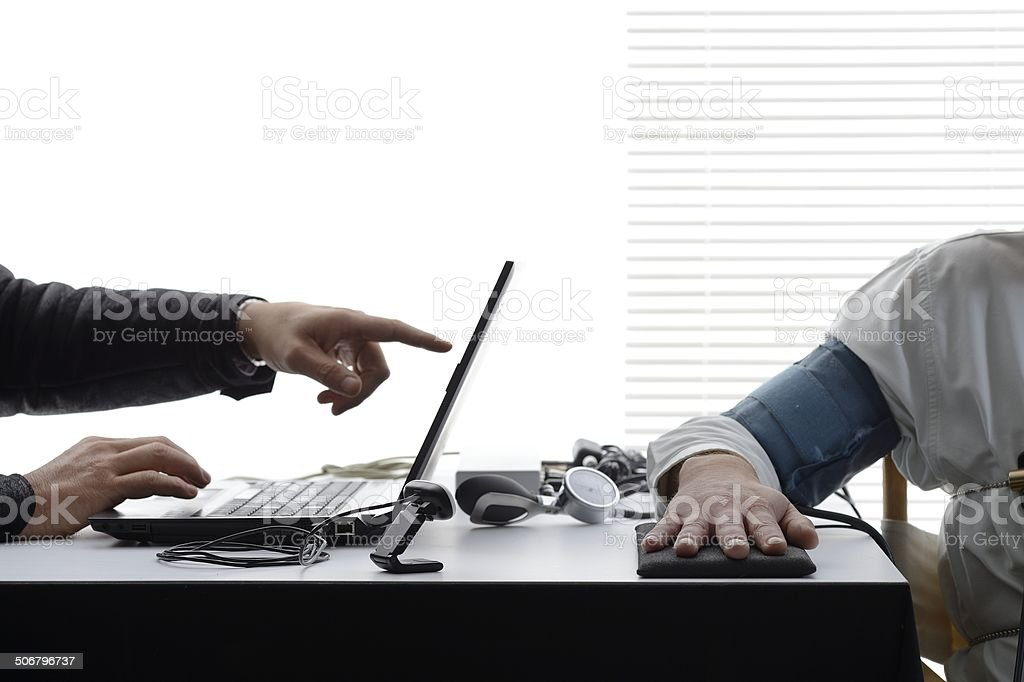 Close-up on hands and polygraph testing equipments stock photo