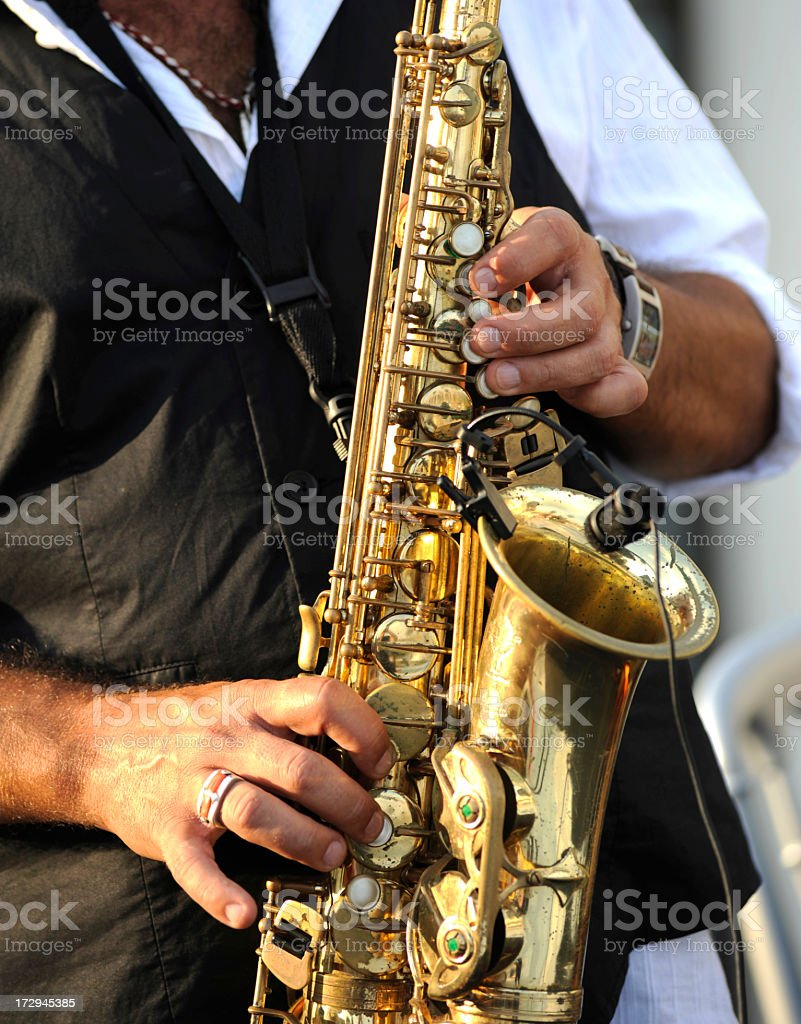 Close-up on hands playing a saxophone royalty-free stock photo