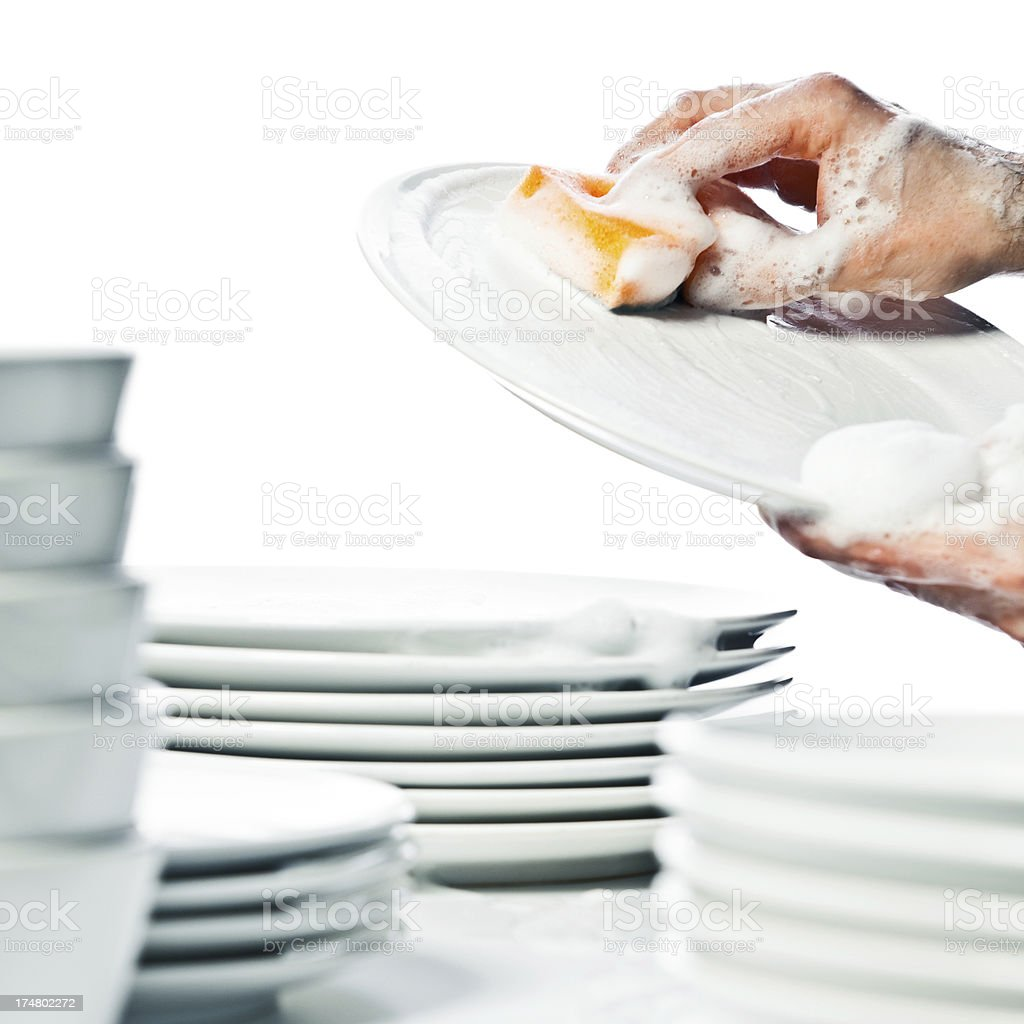 Close-up on man washing dishes in the kitchen stock photo