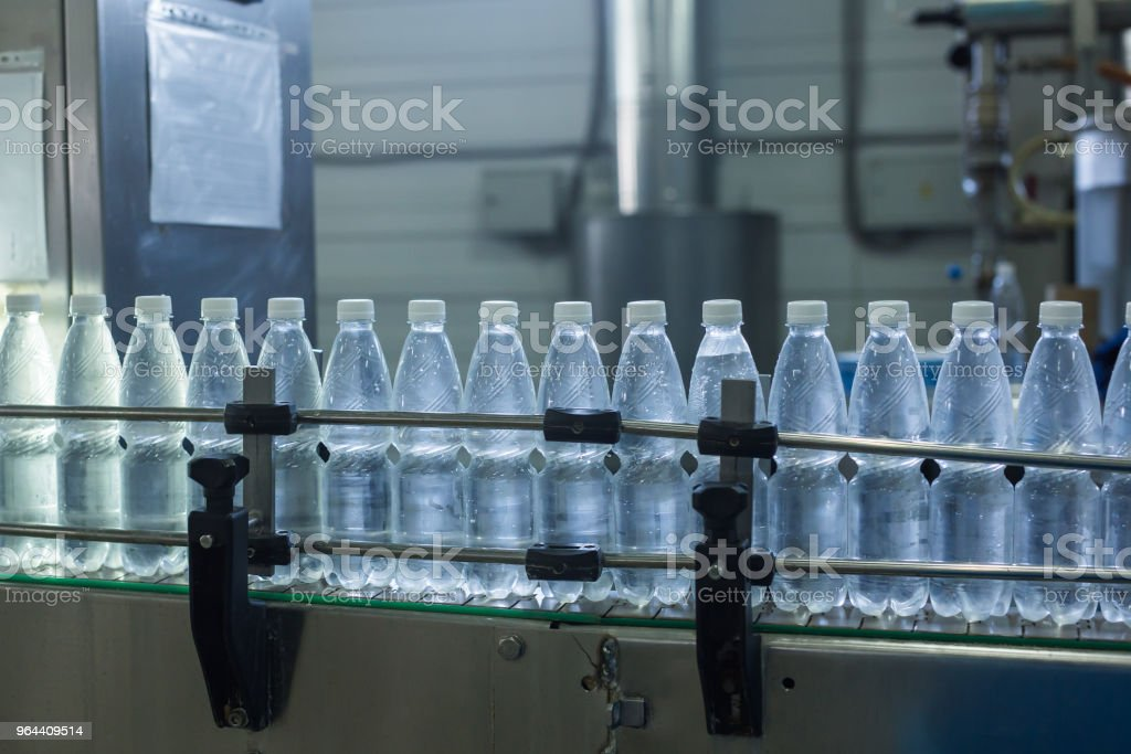 Closeup on mineral water bottles in raw and lines - Royalty-free Blue Stock Photo