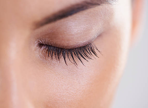 closeup on perfection - eyelid stock photos and pictures