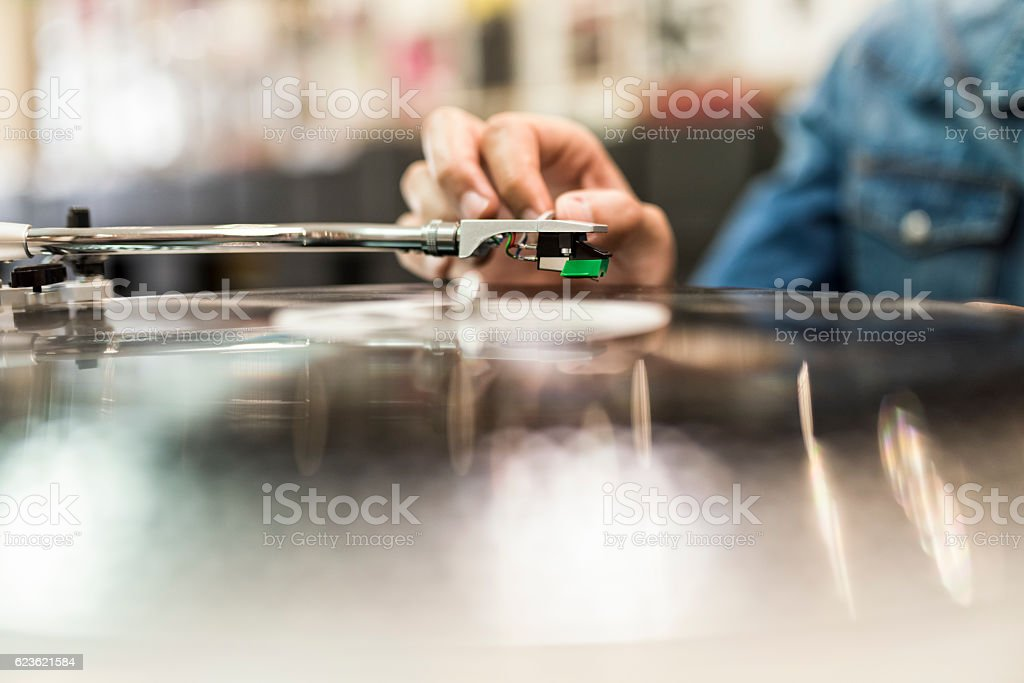 Close-up on player stylus on a rotating disc. Music, vinyl stock photo