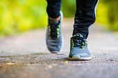 istock Close-up on shoe of athlete runner man feet running 494437762