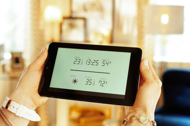 Closeup on smart home weather station in hands of housewife picture id1138130339?b=1&k=6&m=1138130339&s=612x612&w=0&h=fyhlkpxe3c2quajtwpwlsk6al1ivanokc7qyodp0gqy=