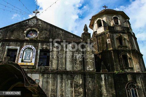 Close-up on the facade of Our Lady of Candelaria Parish Church in Silang, Spanish colonial style,  first built in 1585, Cavite Province, Luzon island, Philippines. Declared a National Cultural Treasure by the National Museum of the Philippines on 3 February 2017.