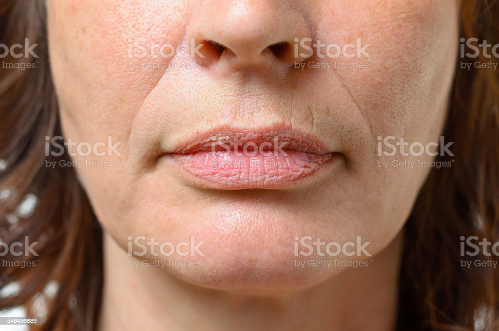 Closeup on the mouth of a middle-aged woman stock photo