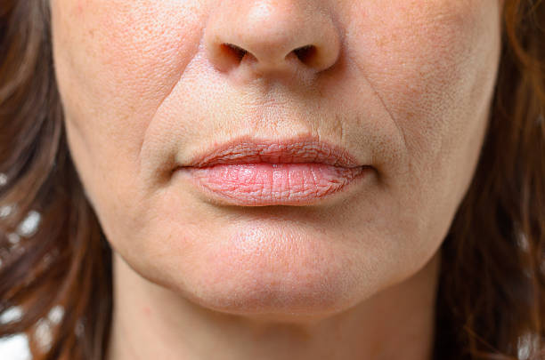 Closeup on the mouth of a middle-aged woman bildbanksfoto