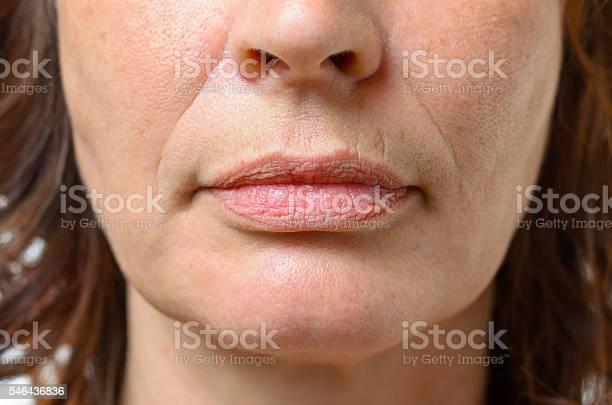 Closeup On The Mouth Of A Middleaged Woman Stockfoto en meer beelden van Bruin haar