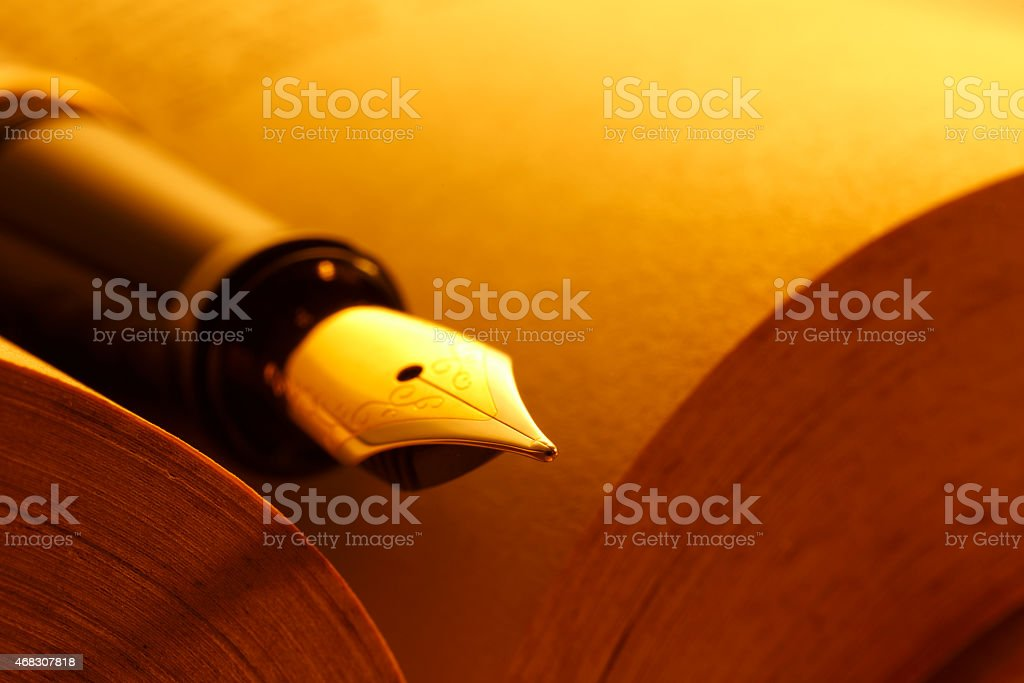 closeup on the Open book and pen - Stock Image stock photo