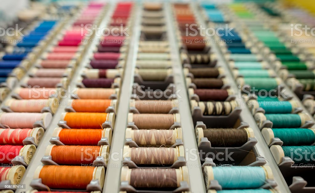 Close-up on threads at the tailor stock photo