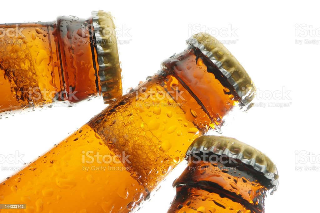 Closeup on three amber beer bottles with caps royalty-free stock photo