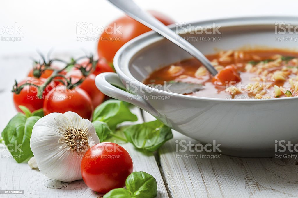 Close-up on tomato soup made of garlic and basil royalty-free stock photo