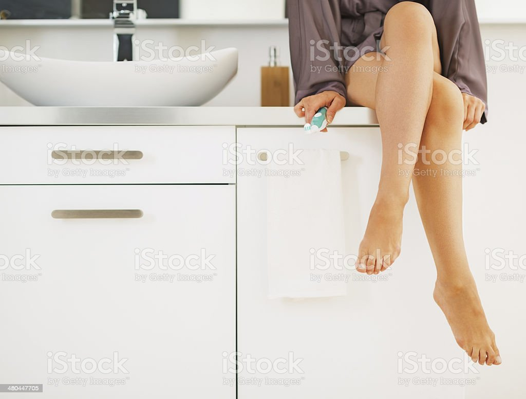 Closeup on toothbrush in hand of young woman stock photo