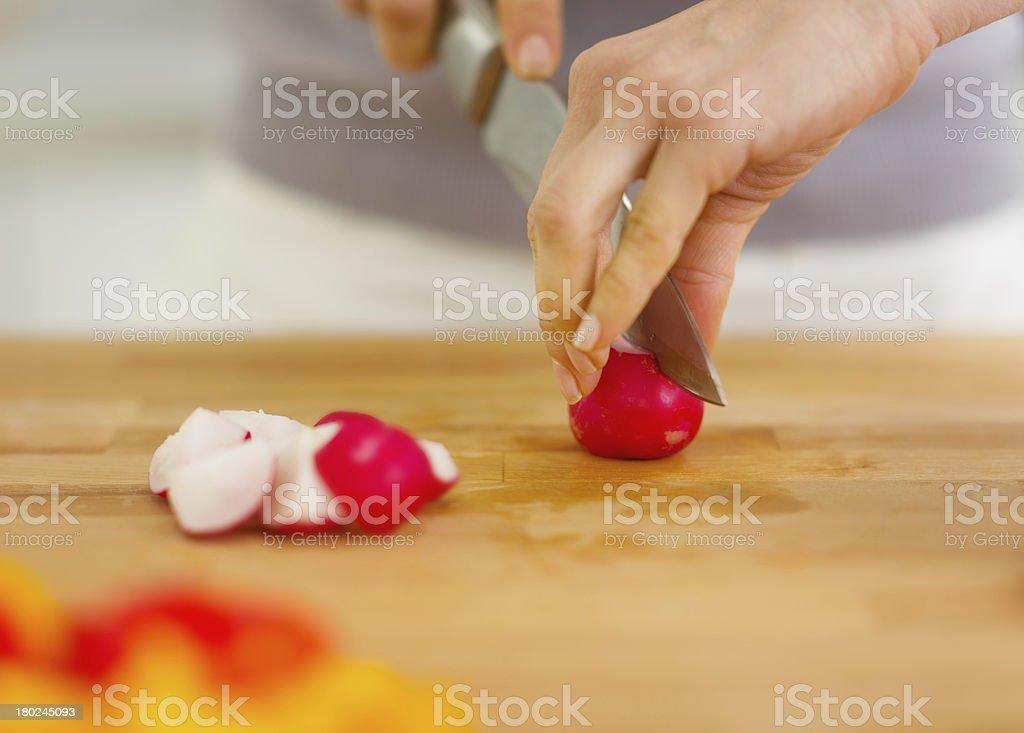 Closeup on woman cutting radishes royalty-free stock photo