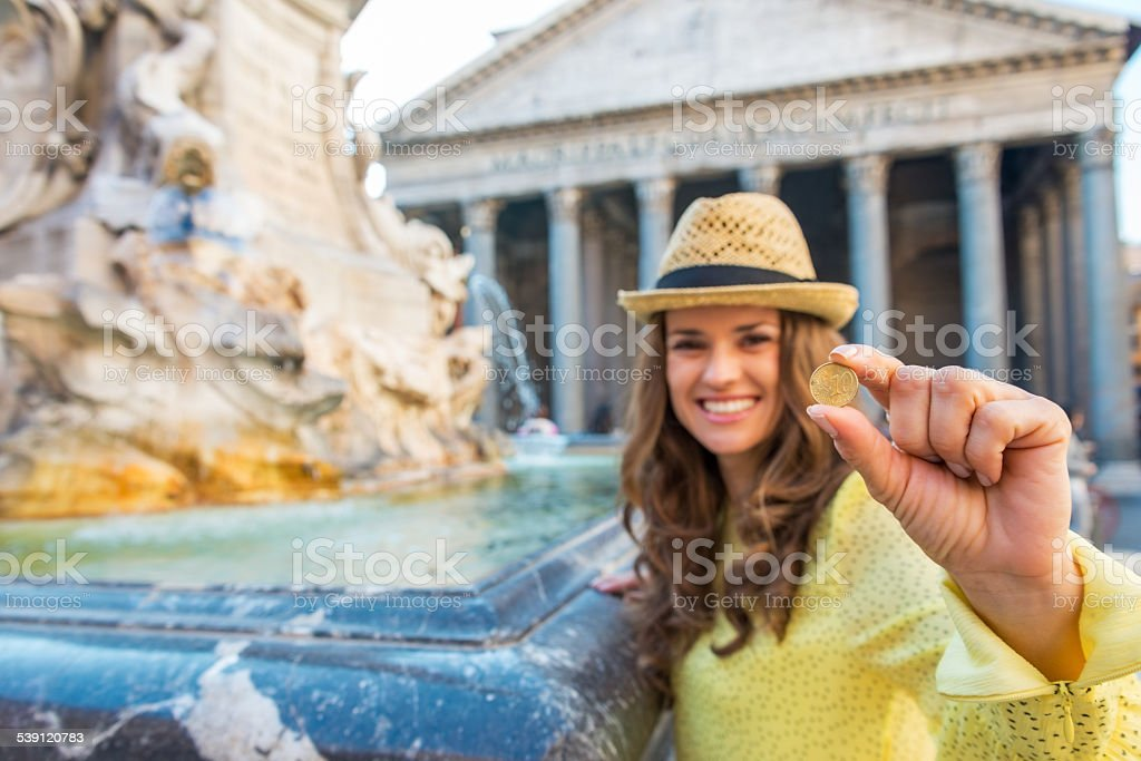 Closeup on woman showing coin near fountain in rome, italy stock photo