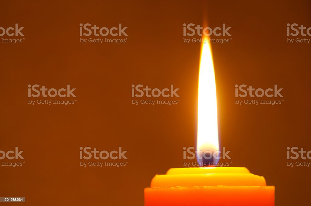 Close-up One candle flame at night stock photo