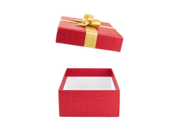 closeup open and empty red gift box with gold ribbon bow isolated on white background open and empty red gift box with gold ribbon bow isolated on white background, surprise in holiday event gift box stock pictures, royalty-free photos & images