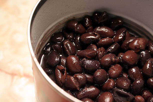 Close-up opened can of black beans stock photo