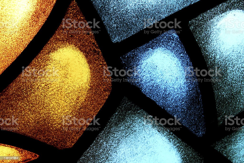 Close-up orange and blue stained glass window stock photo