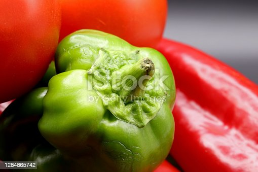 close-up organic  fresh red and green peppers