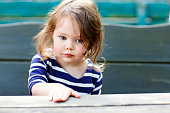 istock Close-up outdoor portrait of beautiful adorable toddler girl 646391344