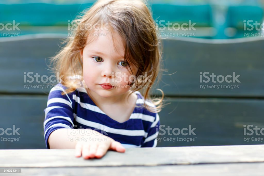 Close-up outdoor portrait of beautiful adorable toddler girl stock photo