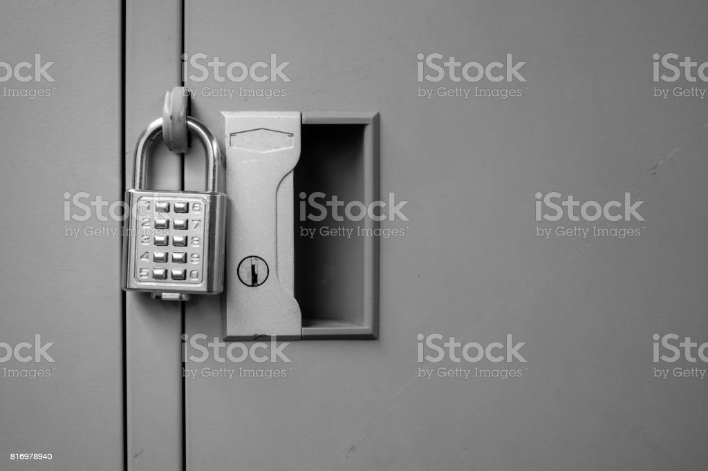 closeup padlock with key number hanging on locker for concept