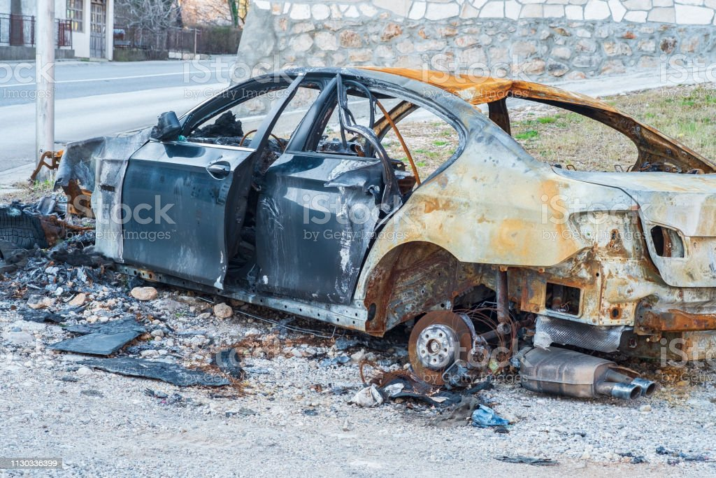 Close-up passenger car involved in accident on the road and burned...
