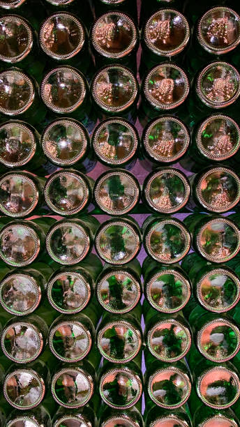 Closeup pattern from the bottom of old dark dusty beer bottles. Concept store. stock photo