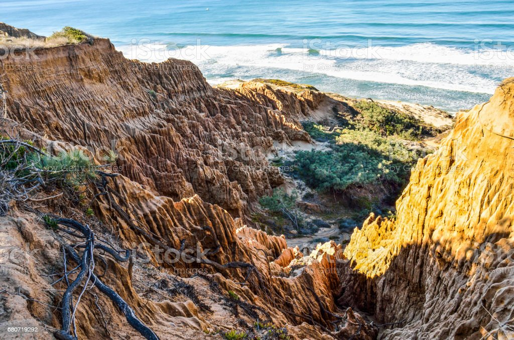 Closeup pattern of torrey pine eroded sandstone cliffs on coast in La Jolla by San Diego stock photo