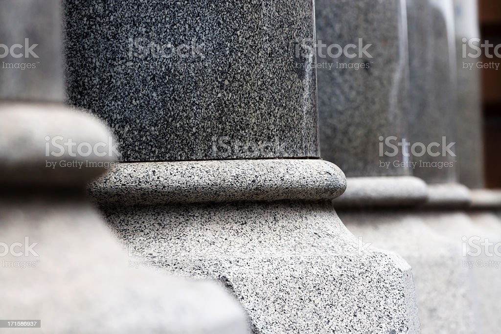 Closeup pedestals of granite columns stock photo