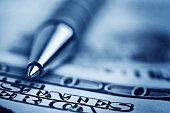 istock close-up pen on the money 118944527