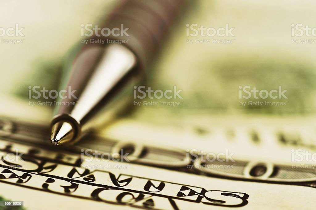 close-up pen on the money royalty-free stock photo