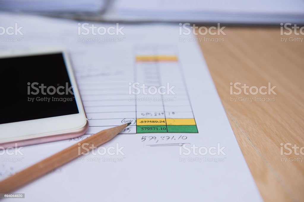 Closeup  pencil with  finance business sheet and phone . Business concept. stock photo