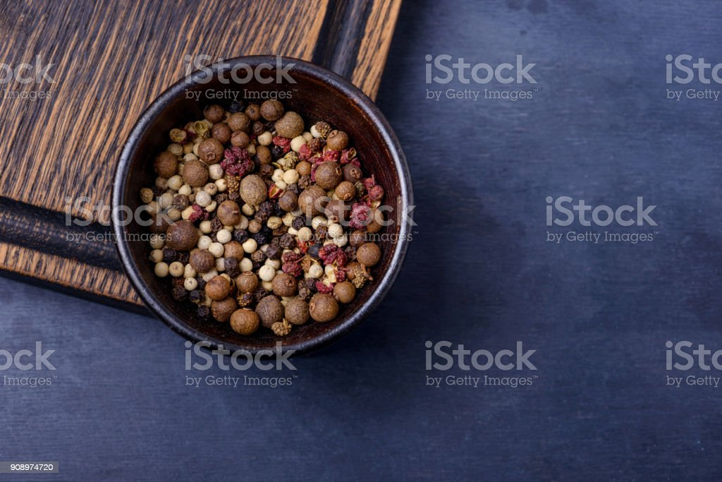 Closeup pepper in bowl on dark background stock photo