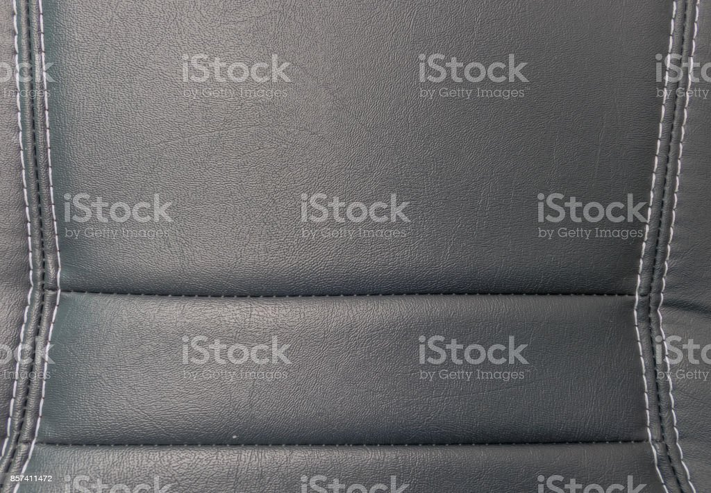 closeup perforated artificial black leather background texture stock photo