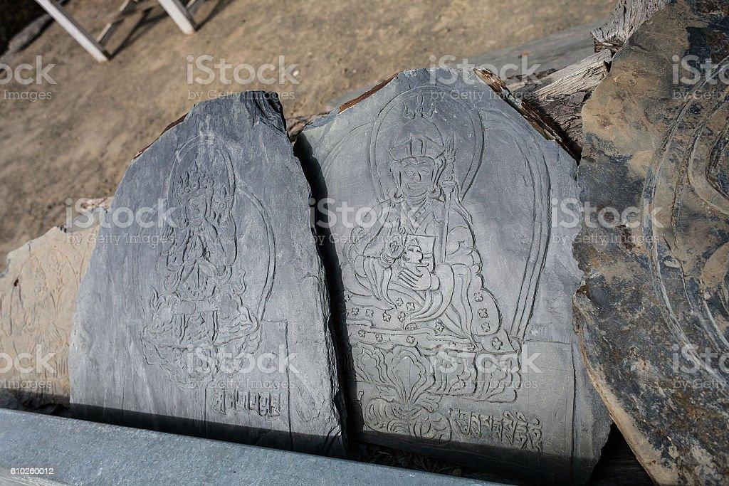Closeup Photo Autentic Draw Stone Budda Symbols and Mantras. Horizontal стоковое фото