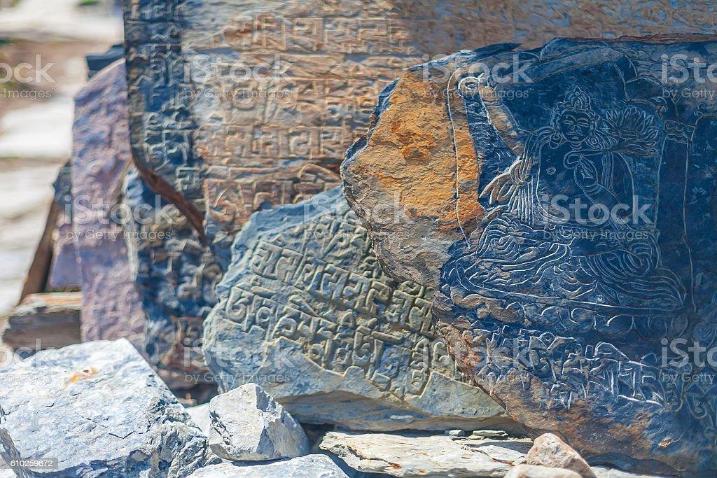 Closeup Photo Autentic Draw Stone Buddist Symbols and Mantras. Horizontal стоковое фото