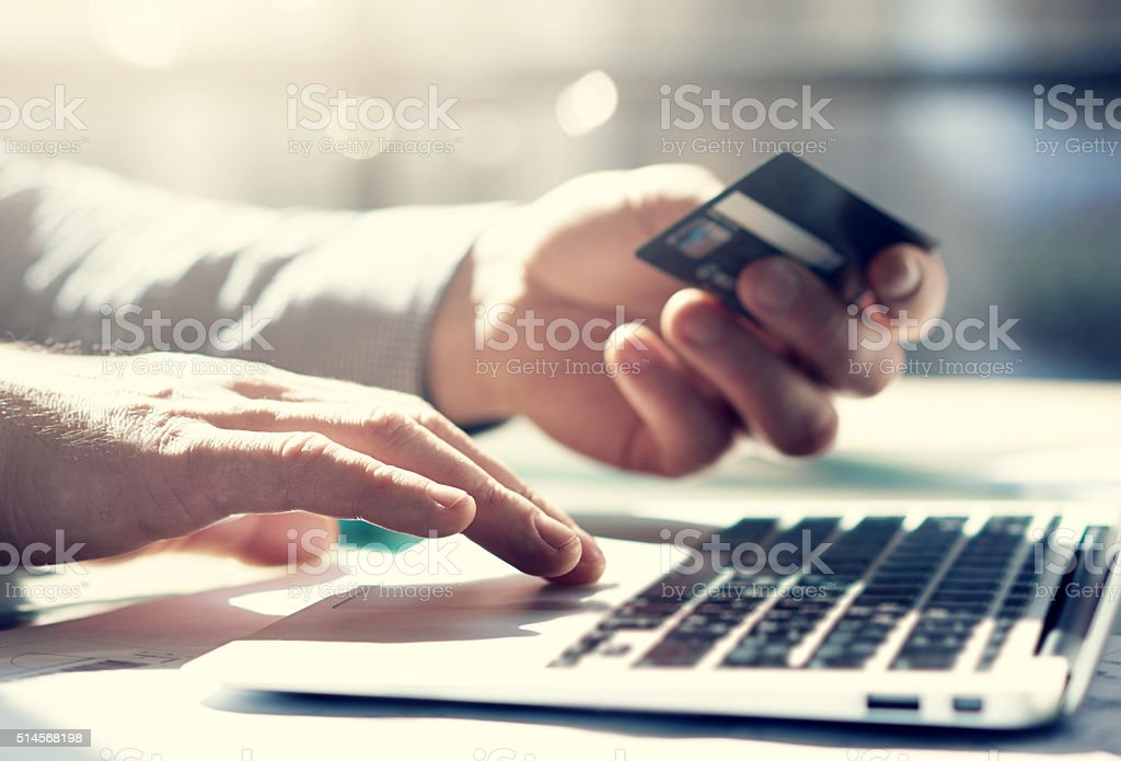 Closeup photo businessman working with generic design notebook. Online payments stock photo