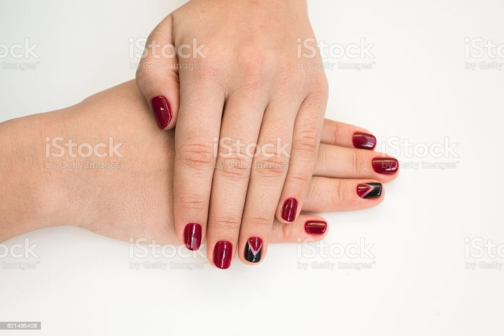 Closeup photo of a beautiful female hands with red nails foto stock royalty-free