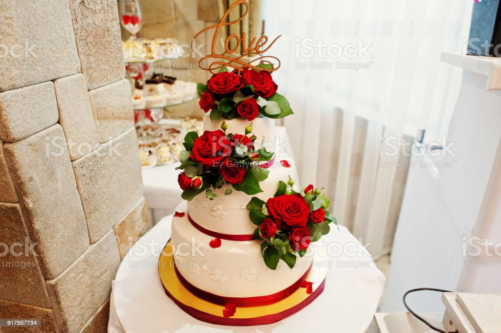 Closeup Photo Of A Big White And Red Wedding Cake Decorated With ...