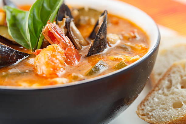 Close-up photo of a bowl of mussel, shrimp and scallop soup