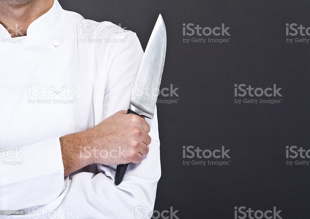 Closeup photo of a chef's knife being held up stock photo