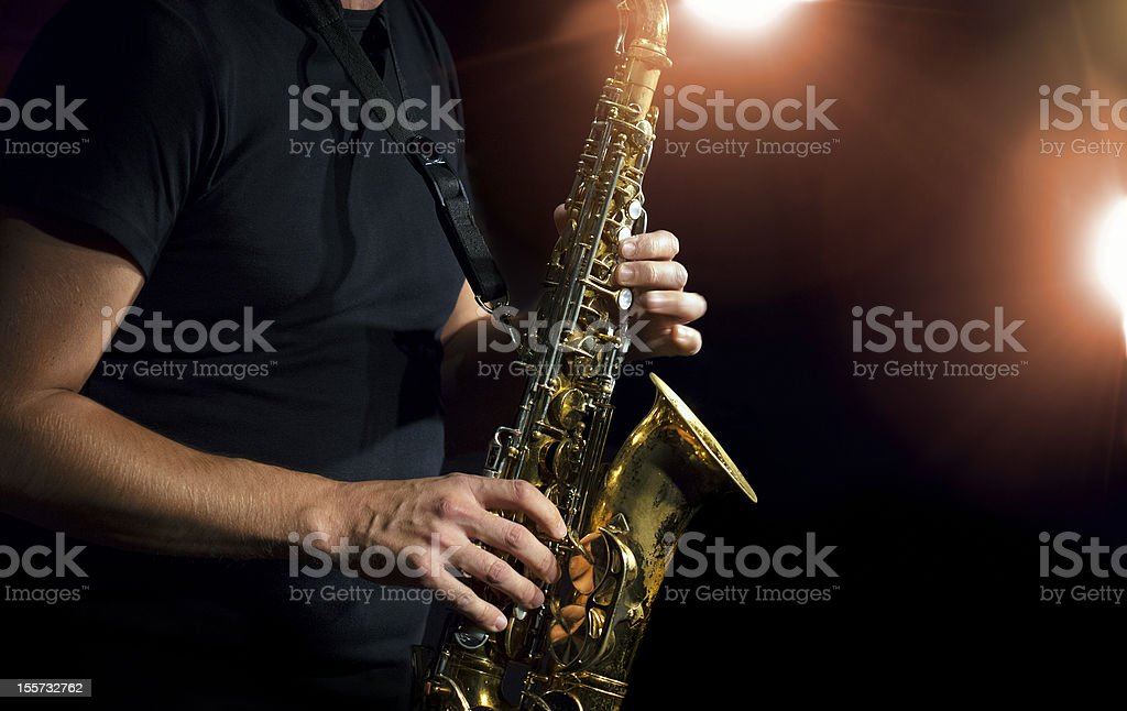 Close-up photo of a person playing a saxophone - Royalty-free Horizontal Stock Photo