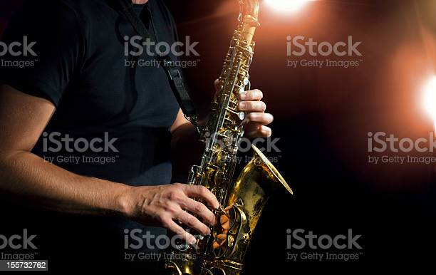 Closeup Photo Of A Person Playing A Saxophone Stock Photo - Download Image Now