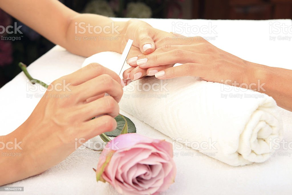 Close-up photo of a woman getting a manicure royalty-free stock photo