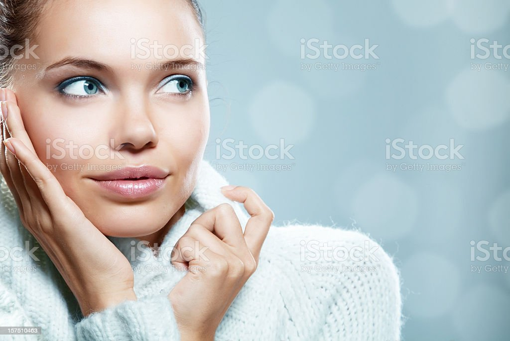 Close-up photo of a woman in a cozy sweater royalty-free stock photo