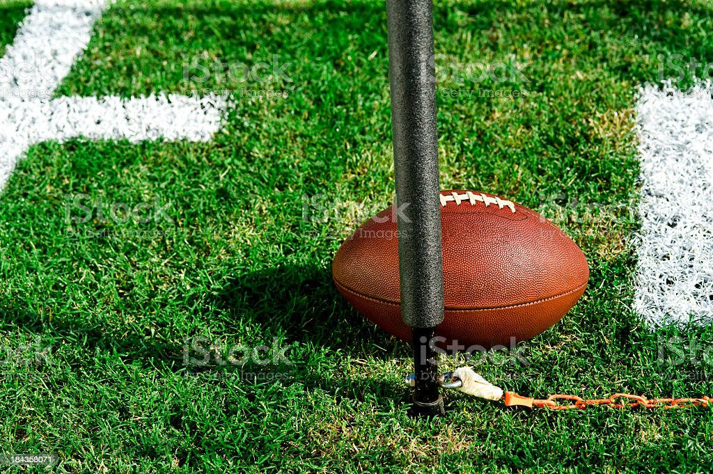 Closeup photo of an American football and first down post stock photo